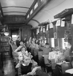 From the 1920s to the early 1960s, children who lived in remote parts of northern Ontario went to a very special school. Their school came to them once a month or so and stayed a week at a time. School was part of a railway car pulled by a train. Half the car was the teacher's home, the other half was a classroom. It had desks of different sizes for students of various ages, blackboards, maps, textbooks and books to read. Most of the schoolchildren's fathers worked for the railway, others were trappers, miners and farmers.