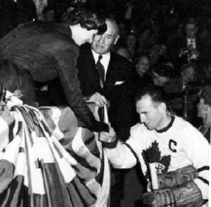 Queen Elizabeth II congratulates Maple Leaf Captain, Ted Kennedy, on her first visit to Canada in 1951
