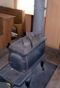 A typical cast iron, pot-belly stove.