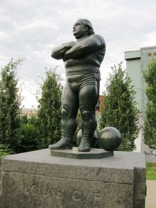 Monument to Louis Cyr by Robert Pelletier in Place des Hommes-Forts in Montreal